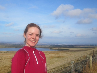 Wk4 Happy girl in the sunshine up a hill.